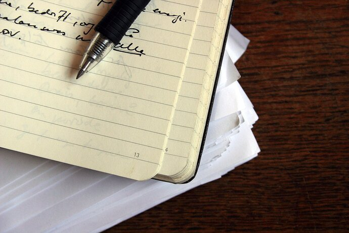 A diary with a pen