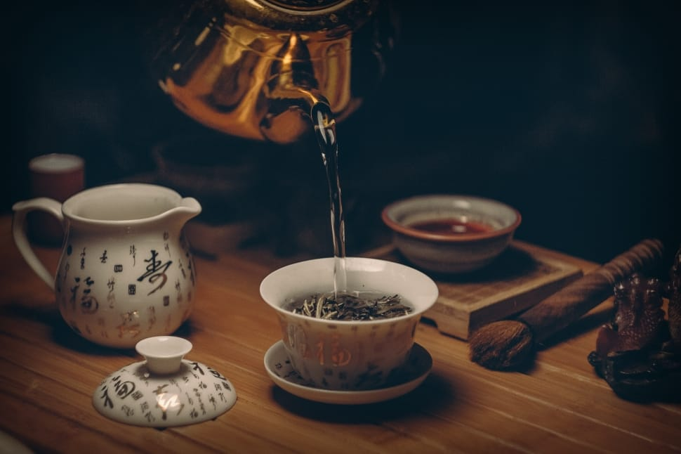 gold-kettle-pouring-hot-water-on-cup-of-tea-wallpaper-preview