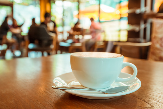 cup-hot-coffee-table-cafe-vintage-retro-color-effect_1484-1279