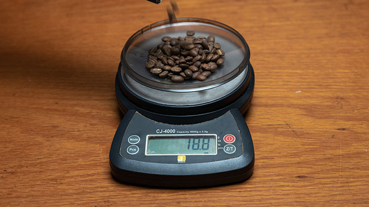 weighing whole coffee beans